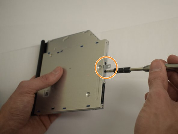 With a smaller phillips head screwdriver, remove the screws on the back of the drive, then remove the small metal bracket.