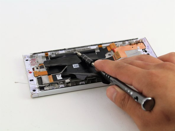 Remove the five 4mm T5 screws connecting the side panel to the power button flex cable.