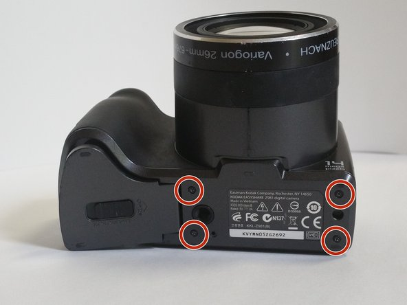 Image 1/2: Eight (8) '''3mm''' screws on the lower portion of the camera