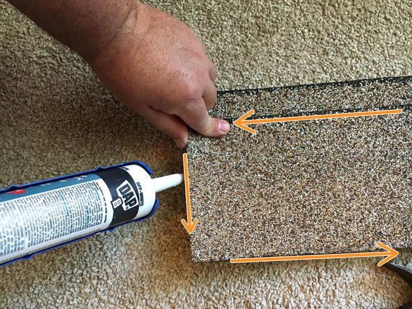 Slightly lift the edges of the shingle and apply a thin layer of cement along it.