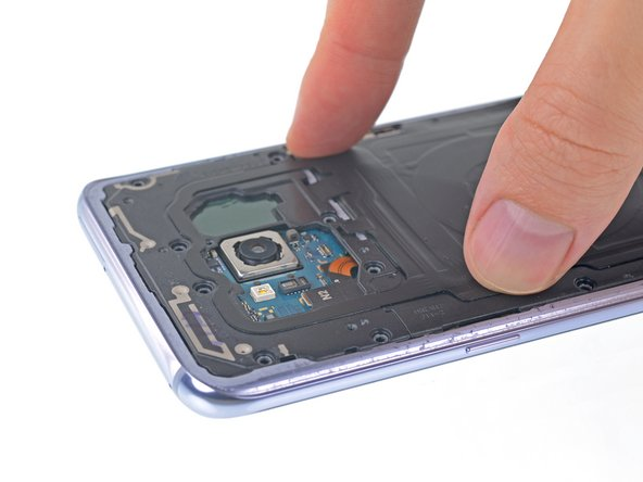 To reinstall, first insert the top edge of the assembly into the phone's frame, and then gently press down on the rest of the assembly to snap it into place.