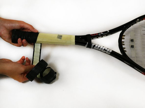 Some older tennis racquets may have a few staples holding the grip to the buttcap. Use the staple remover to take them out.