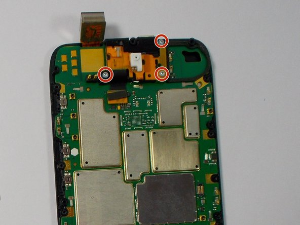 Remove the three Torx T5 screws that locks the front facing camera to the motherboard.