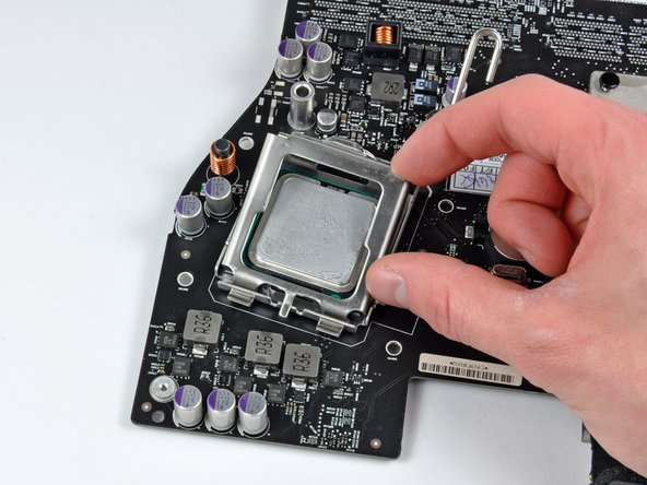 Rotate the CPU clamp away from the CPU.