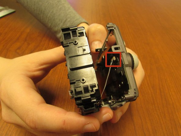 Using the plastic opening tools, carefully open the case, making sure to not tear the white circuit ribbon.