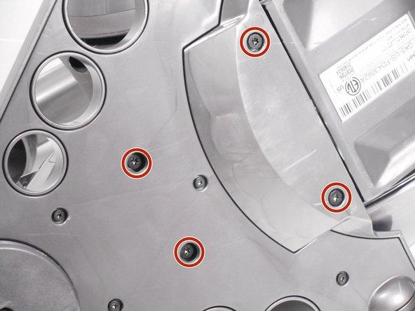 Remove the four 18.0 mm Torx 15 screws.
