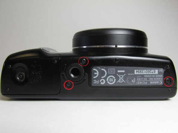 Put the camera with the lens facing up, turn it to the side where the Cover battery is located.