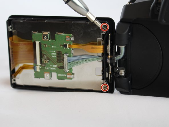 Remove the 2 screws located on the inner corners of the inside of the LCD screen.