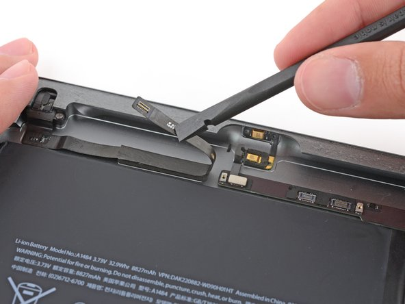 Fold the headphone jack cable out of the way.