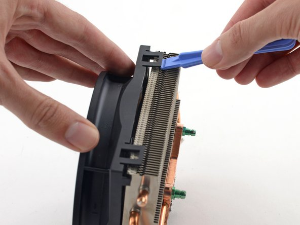 Use a plastic opening tool to pry the two clips on one side out of the channel in the side of the heat sink.
