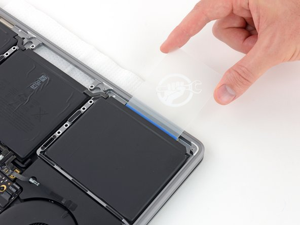 Gently work the card deeper under the battery cell to break up the adhesive securing it in place.