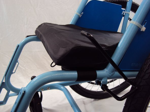 Image 1/2: Place the seat cushion on top of the plastic seat with the angled side in front.