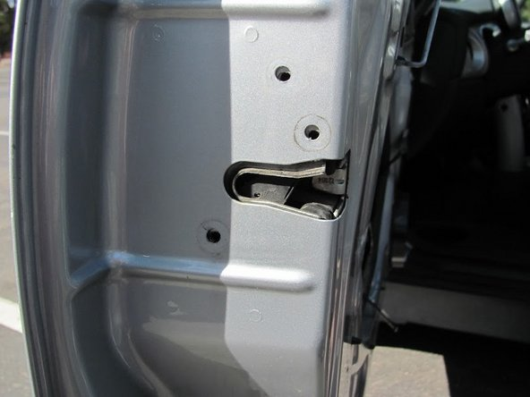 The actuator mechanism is attached to the car door with three bolts, which are on the end of the door (the left side when looking at the opening). These bolts can be removed with a T25 Torx screwdriver.