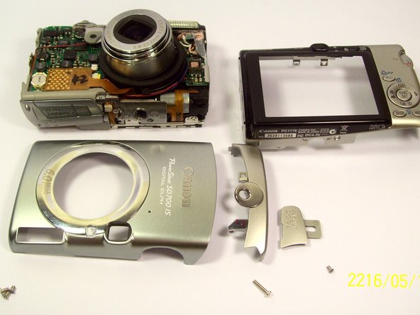 Remove the front back and side casings from the camera.