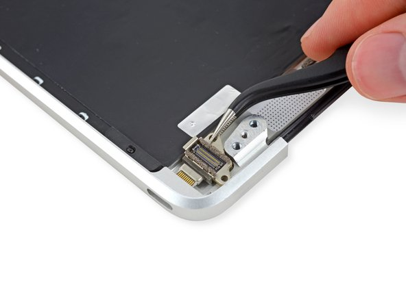 Slide the USB-C port out of its recess in the upper case, and remove the USB-C port.