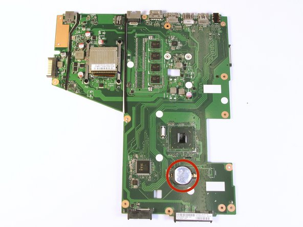 Flip over the motherboard and locate the CMOS battery.