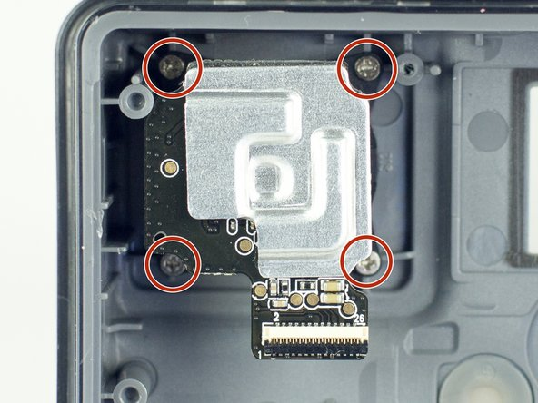 Remove the four screws from the lens.