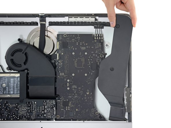 Pull the speaker straight up and remove it from the iMac.