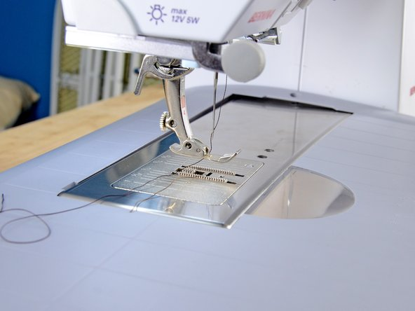 Install the zipper foot into your sewing machine.