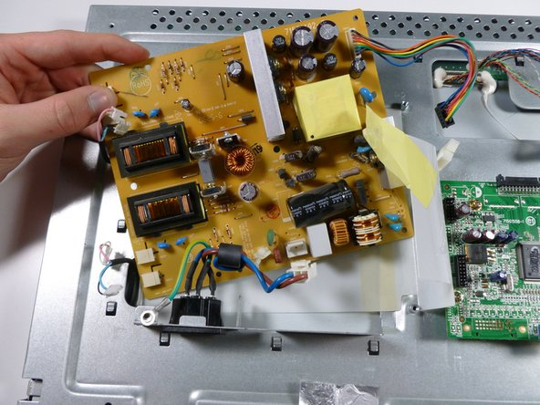 Lift up the power supply and remove it from the rest of the monitor.