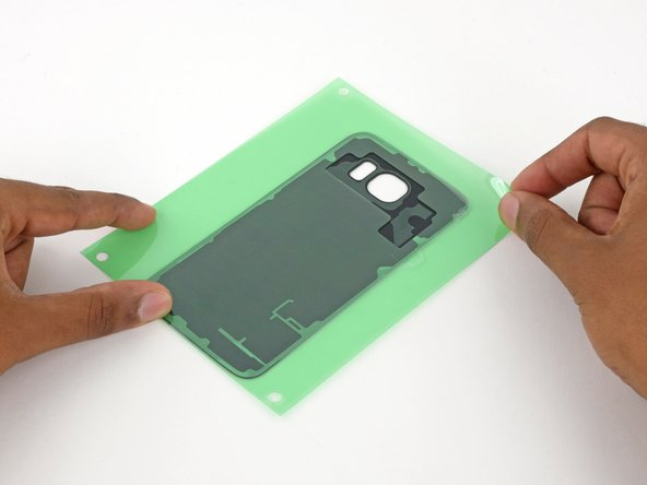 Peel back the outer layer of green film.