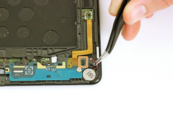 Use a pair of tweezers to disconnect the vibrator cable. It will lift straight up from the daughterboard connector.
