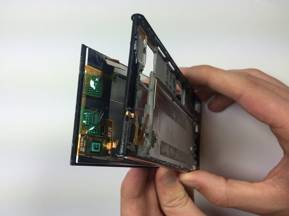 Image 2/2: Avoid forcing the screen from the plastic. This can damage the screen along with the internal wiring. Take this step very slowly, and go back to remove any extra adhesive if necessary.