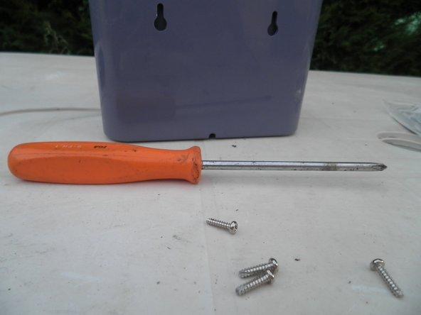 Image 3/3: Remove screws using a screwdriver.