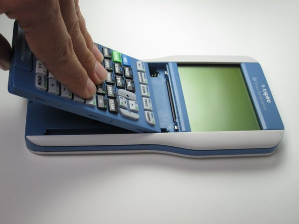 Slide the keypad directly into where it connects to the calculator until you hear a click.  Readjust as necessary.