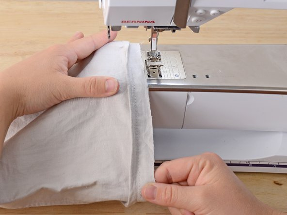Insert the freshly cut edge of the hem into the sewing machine.