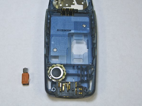 Image 3/3: The vibrator is the small orange box located near the bottom of the phone.