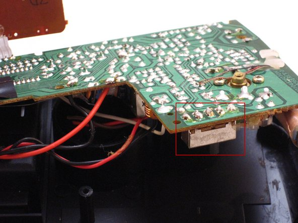 Image 1/3: Carefully apply the hot soldering iron to the solder on top of the AM-FM pins.