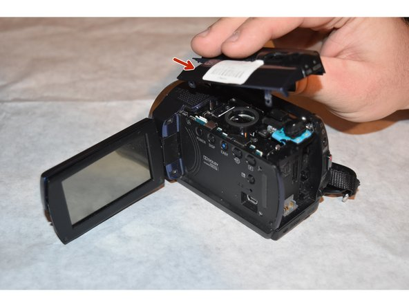 Remove the top plastic housing of the camera. All screws attaching the housing have previously been removed.