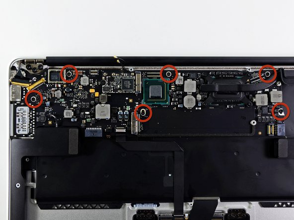 Remove the six 6.3 mm T5 Torx screws securing the logic board to the upper case.