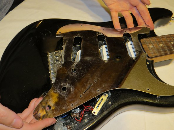Now that the electronics have been freed, you may remove the pickguard.