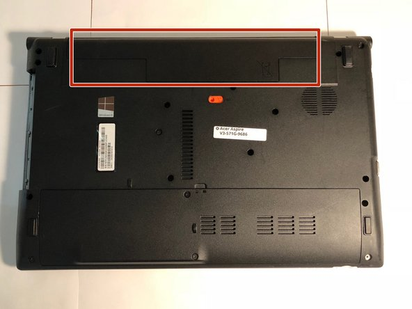 Turn the laptop upside down to locate the battery at the top of the laptop.