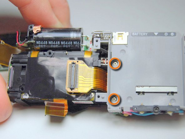 Image 2/3: Lift and remove the flash unit from the left side of the assembly.