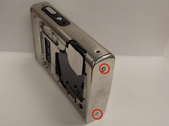 Remove the two screws located on the left side of the camera using a Phillips #00 screwdriver.