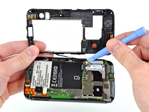An antenna is mounted in the rear half of the phone and must be disconnected before further disassembly.