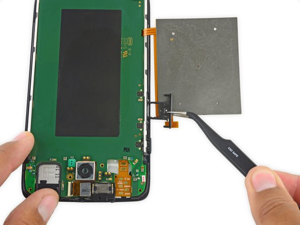 Remove the SIM  card holder/volume button rocker.