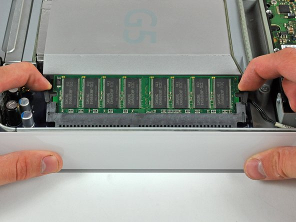 Image 1/3: Pull the RAM chip straight away from its socket.