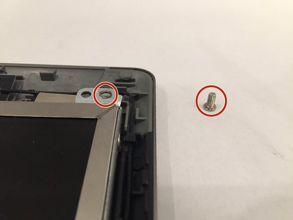 Using the Philips #0 screwdriver, remove the four 1.5mm screws at the corners of the screen.