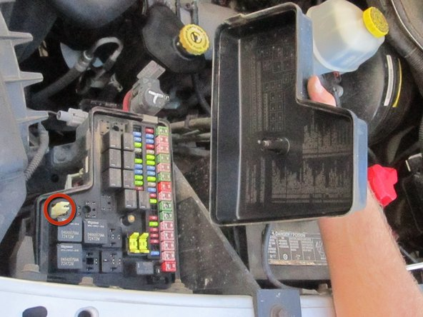 Remove the nut and the cover of the fusebox. Use the inside of the fusebox cover to determine which fuses you need to check.