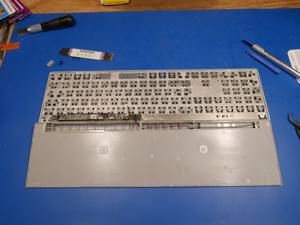Image 1/3: With the keyboard apart, it is evident that Microsoft used double sided tape around each key and glue on the exterior keyboard edge.