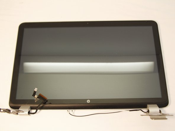 Use a plastic opening tool along the gap between the screen and the back panel to separate the two pieces.