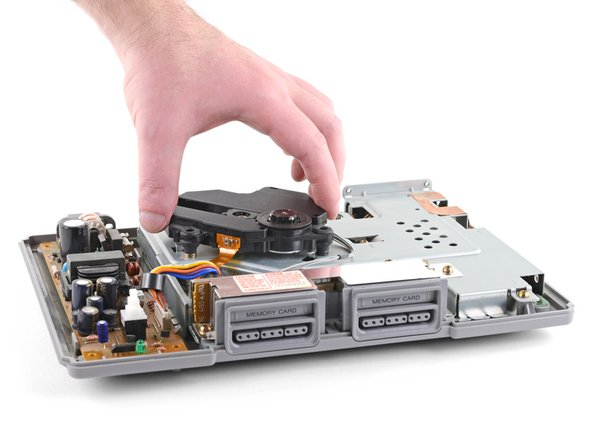 Lift the optical drive straight up to remove it.