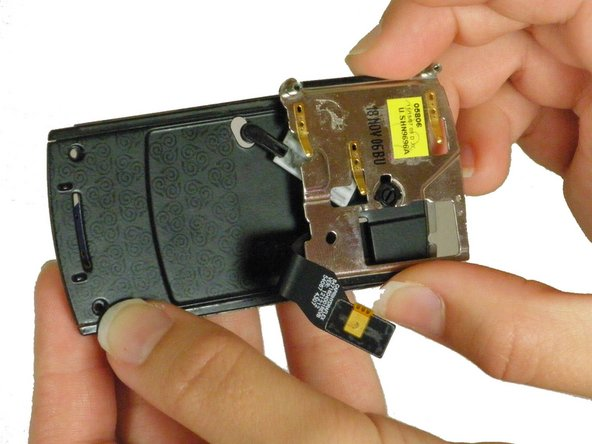 Turn the phone around and slide the slider down its track until it is free of the casing.