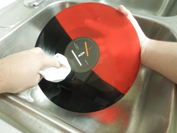 Move the record around using the edge of the record and the palms of your hands (as to not touch the grooves).
