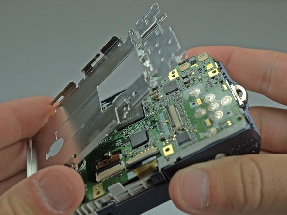 Image 2/2: Remove the LCD base plate.