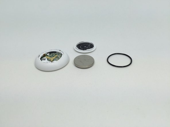 Image 2/3: Removing the battery also exposed a seal ring used to make the enclosure waterproof.